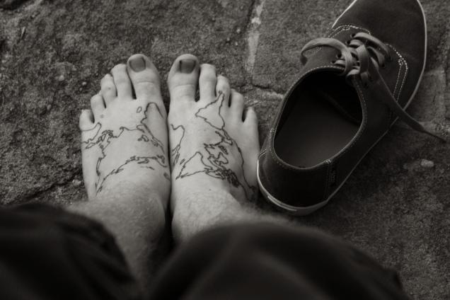 Black Ink World Map Tattoos On Feet