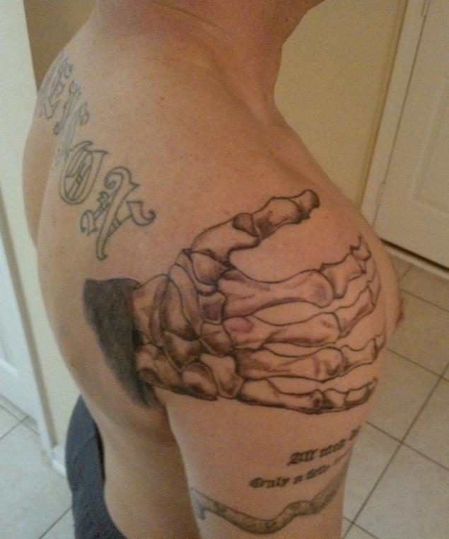 Bone Hand Death Tattoo Design On Men Shoulder