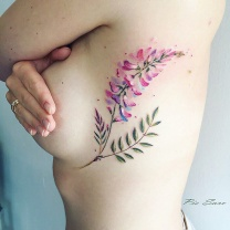 Leaf Tattoo On Girl Ribs